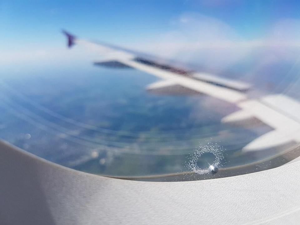 "Those <a href=""https://time.com/3903109/airplane-window-holes/"" rel=""nofollow noopener"" target=""_blank"" data-ylk=""slk:holes in airplane windows"" class=""link rapid-noclick-resp"">holes in airplane windows</a> are called ""breather"" or ""bleed"" holes. Airplane windows have multiple panes, with the breather hole being in the middle to equilibrate between the cabin window and the outside windowpanes—it helps alleviate pressure so that neither the outside nor inside panes crack."