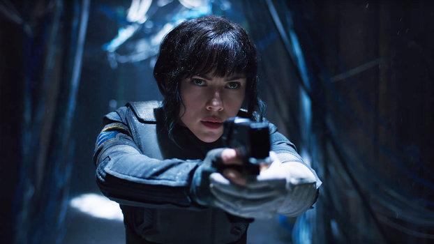 """The first Ghost in the Shell teasers have finally arrived, and Scarlett Johansson is a force to be reckoned with. DreamWorks and Paramount dropped five short, ominous clips on Wednesday that revealed the first look at Public Security Section 9--and Johansson's character """"Major"""" looks fierce.  In one clip, the mechanically-enhanced special-ops agent unplugs from her docking station. She's asked, """"What are you?"""" by a gold-browed subject in another teaser, and packs a gun in t"""