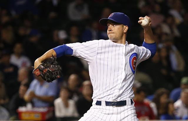 Chicago Cubs starting pitcher Chris Rusin delivers during the first inning of a baseball game against the Pittsburgh Pirates Tuesday, Sept. 24, 2013, in Chicago. (AP Photo/Charles Rex Arbogast)