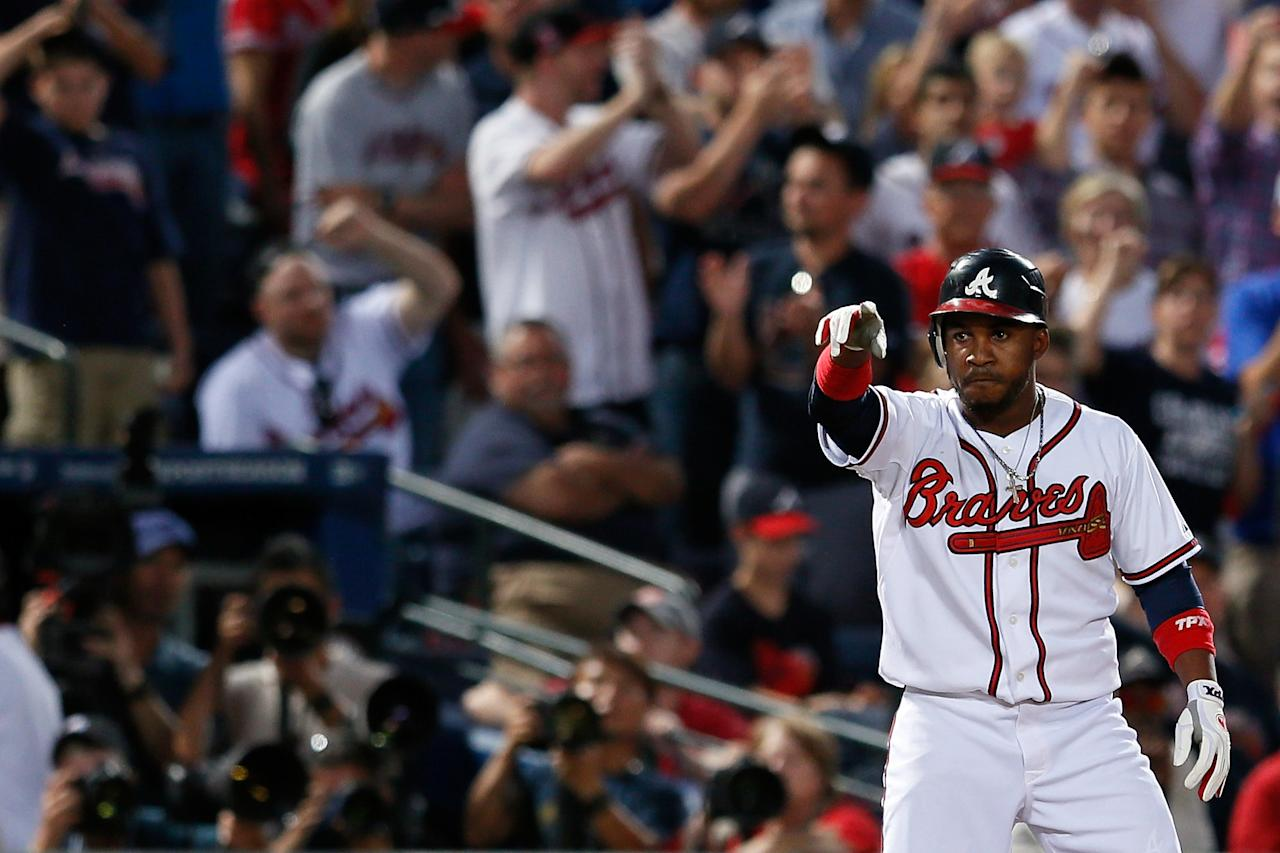 ATLANTA, GA - OCTOBER 05:  Jose Constanza #13 of the Atlanta Braves reacts from thrid base after he hits a triple in the seventh inning against the St. Louis Cardinals during the National League Wild Card playoff game at Turner Field on October 5, 2012 in Atlanta, Georgia.  (Photo by Kevin C. Cox/Getty Images)