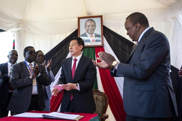 A Chinese special envoy, Wang Yong, signs the visitors' book at the Nairobi Terminus during the commissioning of the upgraded rail line in December 2019