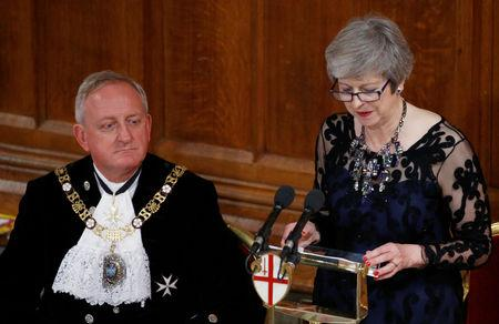 Lord Mayor of London Peter Estlin's listens as Britain's Prime Minister Theresa May delivers a speech during the annual Lord Mayor's Banquet at Guildhall in London, Britain, November 12, 2018. REUTERS/Henry Nicholls