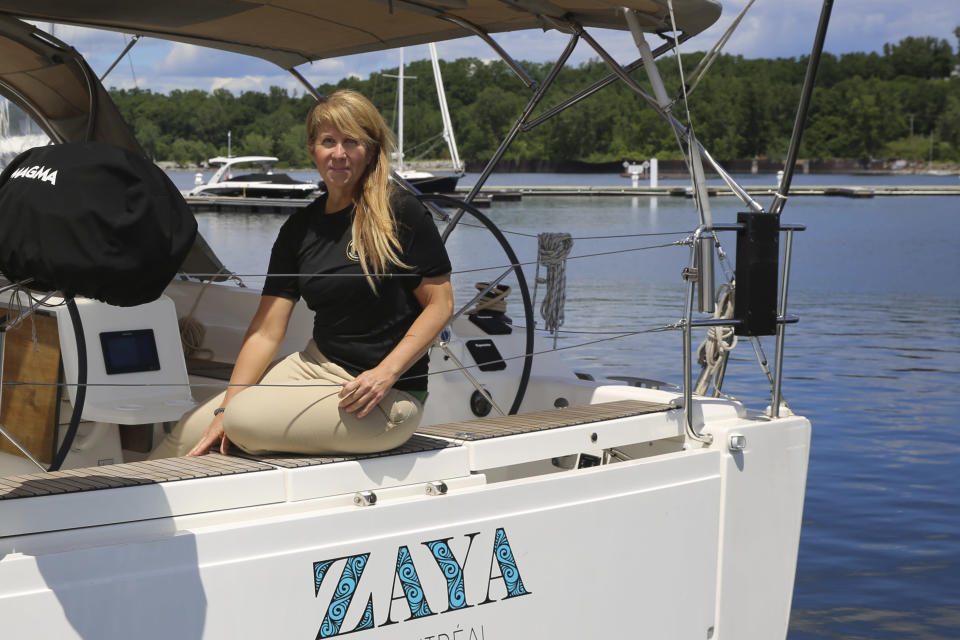 Elizabeth White, of Dream Boat Charters, sits for a photograph on one of her company's rental vessels in Burlington Harbor on Lake Champlain, in Burlington, Vt., Wednesday, June 23, 2021. White says they're hoping the U.S.-Canadian border will reopen soon so Canadian visitors can return. (AP Photo/Wilson Ring)