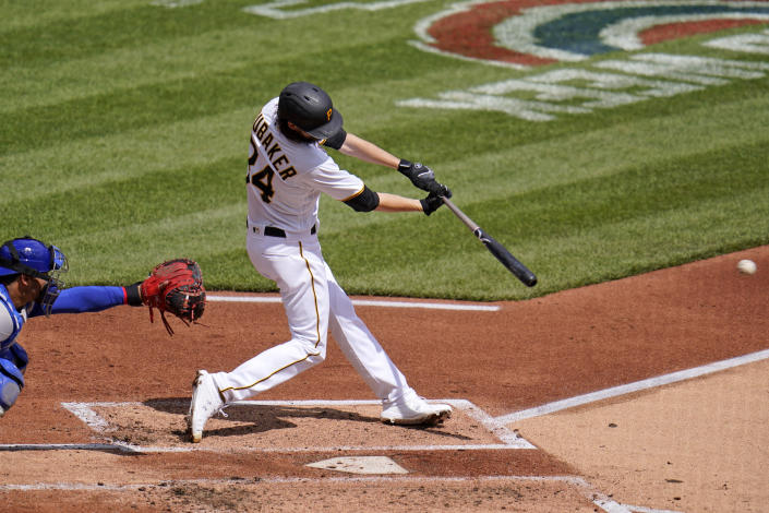 Pittsburgh Pirates starting pitcher JT Brubaker drives in two runs with a single off Chicago Cubs starting pitcher Trevor Williams during the second inning of a baseball game in Pittsburgh, Sunday, April 11, 2021. (AP Photo/Gene J. Puskar)