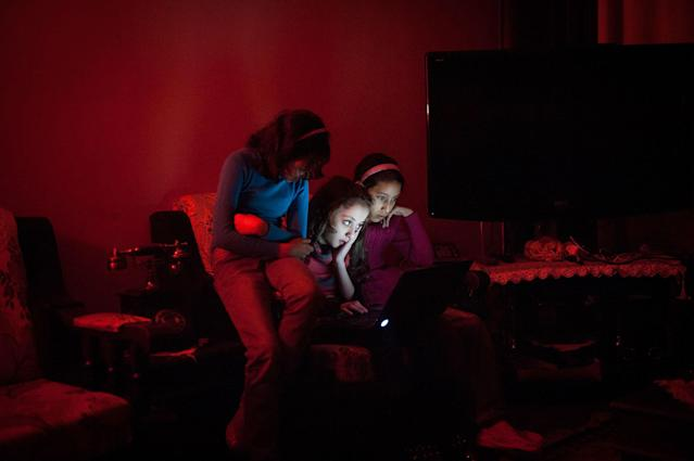 <p>Yara and her friends prepare a dance number during a blackout. Fuel is scarce in Gaza and many families only receive six to eight hours of electricity a day. (Photograph by Monique Jaques) </p>