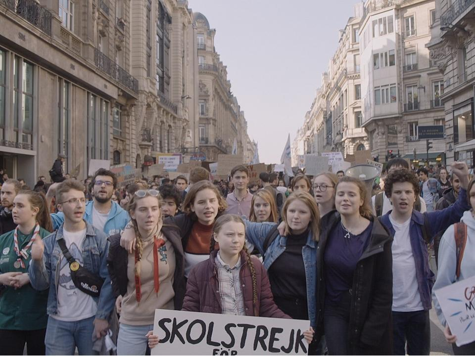 Thunberg marches with a crowd demanding action on the global climate crisisDogWoof