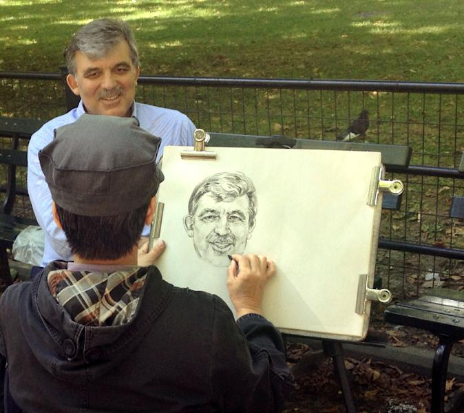 In this Sept. 28, 2013 photo, Turkish President Abdullah Gul has his likeness drawn by an artist on the Poet's Walk in New York's Central Park Saturday. Gul was in town for the United Nations General Assembly where he address the 68th Session on Tuesday Sept. 24 at U.N. headquarters. (AP Photo/Nicole Treska)