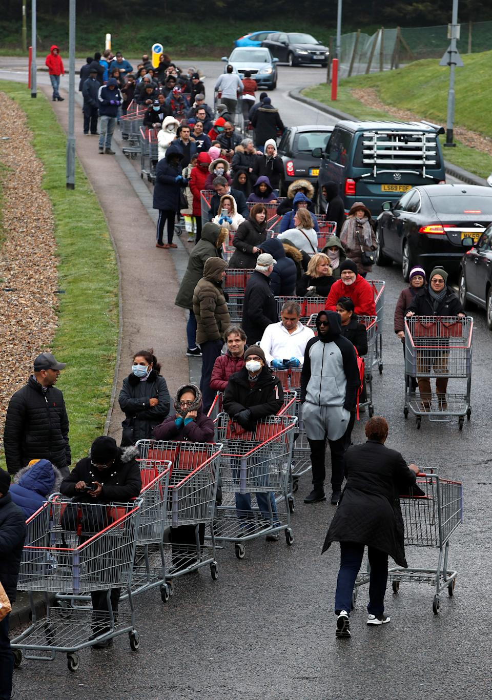 People queue outside of a Costco store in Watford, as the spread of the coronavirus disease (COVID-19) continues, Britain, March 19, 2020. REUTERS/Paul Childs