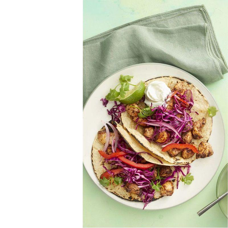 """<p>The chicken in this recipe is tossed with cinnamon and cocoa for a sweet twist on the basic recipe.</p><p><a href=""""https://www.womansday.com/food-recipes/food-drinks/a25940484/chicken-mole-tacos-recipe/"""" rel=""""nofollow noopener"""" target=""""_blank"""" data-ylk=""""slk:Get the Chicken Mole Tacos recipe."""" class=""""link rapid-noclick-resp""""><em>Get the Chicken Mole Tacos recipe.</em></a></p>"""