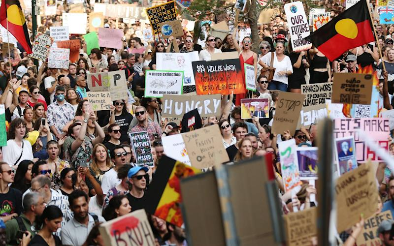 Thousands of people protested in Sydney on Saturday over the government's handling of the fires - Bloomberg