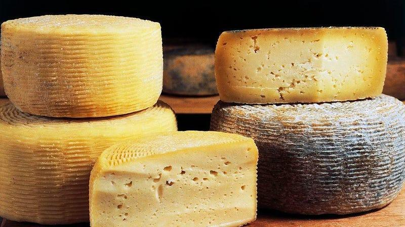 Wheels and wedges of cheese