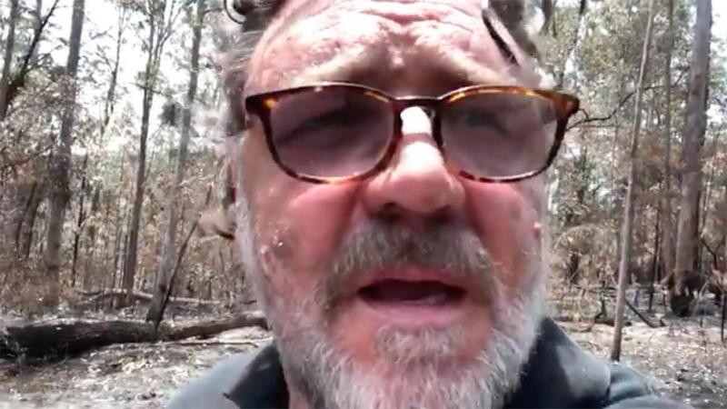 Russell Crowe appears in a self-shot video of his fire damaged property in NSW