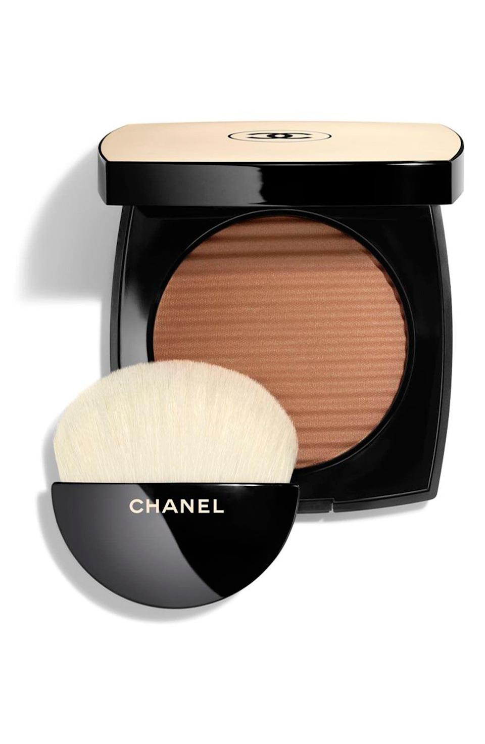 """<p><strong>Chanel</strong></p><p>nordstrom.com</p><p><strong>$58.00</strong></p><p><a href=""""https://go.redirectingat.com?id=74968X1596630&url=https%3A%2F%2Fwww.nordstrom.com%2Fs%2Fchanel-les-beiges-healthy-glow-luminous-color-powder-bronzer-highlighter%2F4633278&sref=https%3A%2F%2Fwww.goodhousekeeping.com%2Fbeauty-products%2Fg36020083%2Fbest-bronzer-for-dark-skin%2F"""" rel=""""nofollow noopener"""" target=""""_blank"""" data-ylk=""""slk:Shop Now"""" class=""""link rapid-noclick-resp"""">Shop Now</a></p><p>The chic, slightly iridescent Chanel powder easily sweeps across your skin, giving you a beachy glow. This bronze powder is<strong> light and buildable, resulting in a healthy glow</strong> for tan and medium skin tones. </p>"""