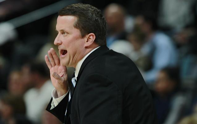 Detroit Pistons head coach John Loyer directs his team against the Denver Nuggets in the first quarter of an NBA basketball game in Denver on Wednesday, March 19, 2014. (AP Photo/David Zalubowski)
