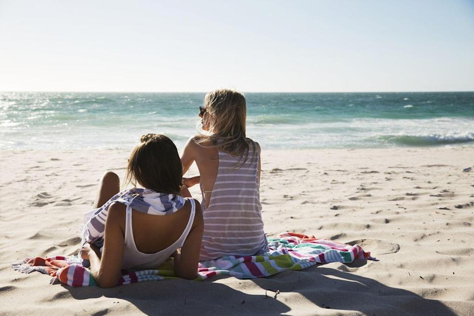 """<p>Being at the beach means you're less likely to be staring at your phone or tablet, and you almost definitely won't be using your computer or television. Too much screen time has been shown to cause poor vision, poor sleep, back and neck pain, and impaired cognitive function. Getting away from it for a few hours of the day can only be a good thing.</p><p>According to Quartz, <a href=""""https://qz.com/1347904/blue-mind-science-proves-the-health-benefits-of-being-by-water/"""" rel=""""nofollow noopener"""" target=""""_blank"""" data-ylk=""""slk:spending time by bodies of water"""" class=""""link rapid-noclick-resp"""">spending time by bodies of water</a> (like the ocean or lake), can counter the dulling effect of too much screen time. That's because the water improves your mood and, again, opens your mind, and you feel more encouraged to experience everything with all of your senses. </p>"""