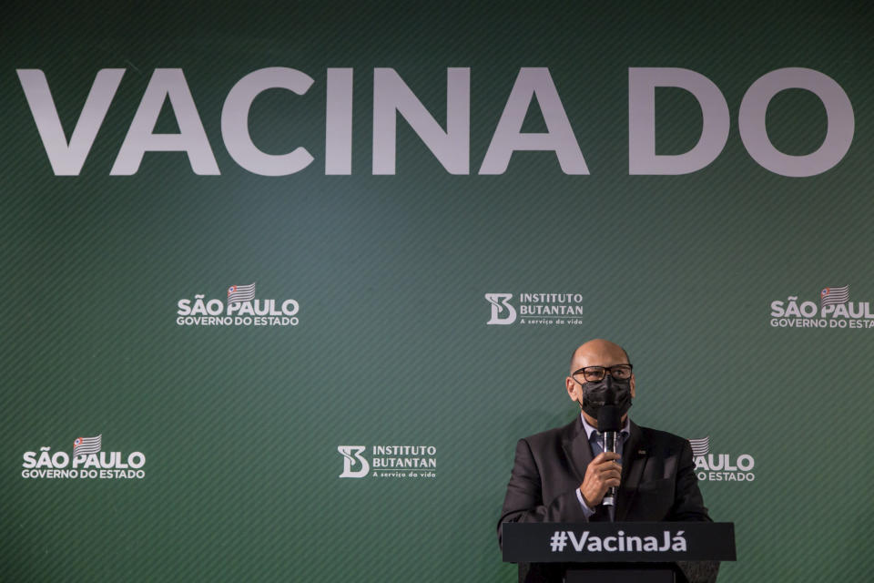 Dimas Tadeu Covas, director of the Butantan Institute, speaks during a press conference regarding the Sinovac COVID-19 vaccines test results, at headquarters of the Butantan Institute in Sao Paulo, Brazil, Wednesday, Dec. 23, 2020. Brazil is closer to getting its first COVID-19 vaccine, as phase 3 trials for a shot made by Chinese biopharmaceutical firm Sinovac have surpassed the 50% efficacy threshold imposed by the country's sanitary agency, said Covas. (AP Photo/Carla Carniel)