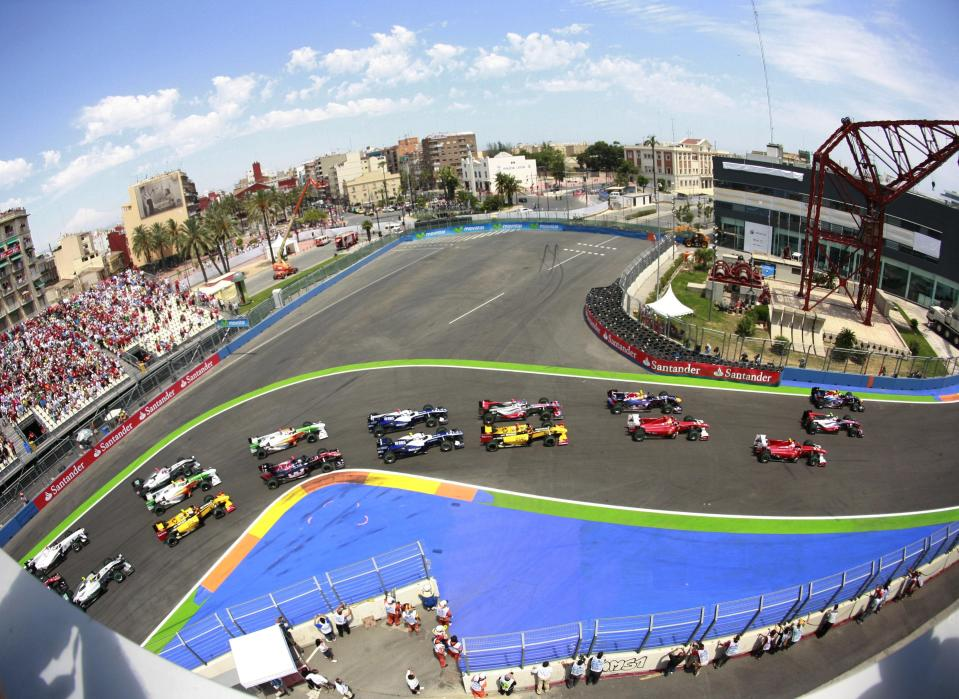 In this June 27, 2010, file photo, an aerial view shows the start of Europe's Formula One Grand Prix at the Valencia street circuit in Valencia, Spain. The start of the 2021 Formula One season has been delayed after the Australian Grand Prix was postponed because of the coronavirus pandemic. (AP Photo/Alberto Saiz,File)