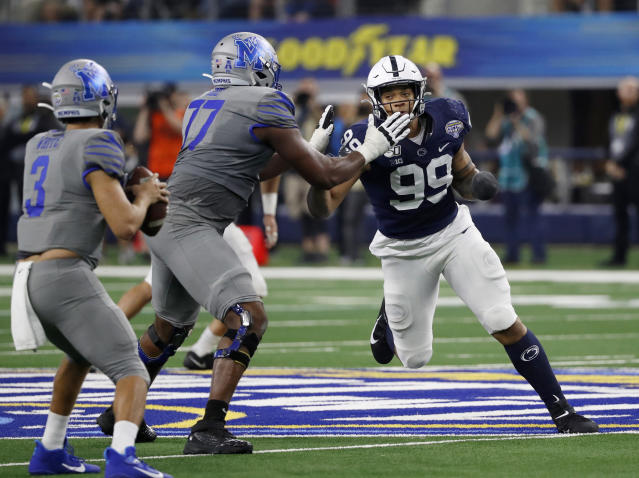 In this Dec. 28, 2019, photo, Penn State defensive end Yetur Gross-Matos (99) faces off against Memphis offensive lineman Obinna Eze (77) while quarterback Brady White (3) looks to pass during the second half of the NCAA Cotton Bowl college football game in Arlington, Texas. Gross-Matos would have liked to be in Las Vegas on Thursday, April 23, 2020, with other NFL draft prospects, but the Penn State defensive lineman is just as comfortable watching it at home. (AP Photo/Roger Steinman)