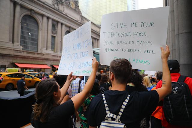<p>Protesters carry signs past Grand Central Terminal in New York City during a protest on June 20, 2018. (Photo: Gordon Donovan/Yahoo News) </p>