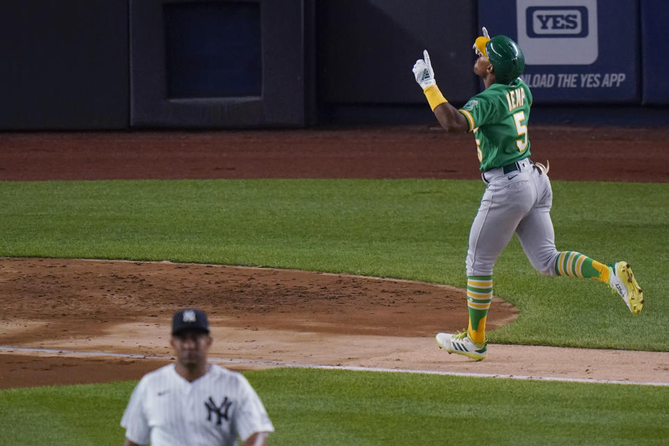 Oakland Athletics' Tony Kemp runs the bases after hitting a three-run home run off New York Yankees relief pitcher Wandy Peralta, left, during the sixth inning of a baseball game Friday, June 18, 2021, in New York. (AP Photo/Frank Franklin II)