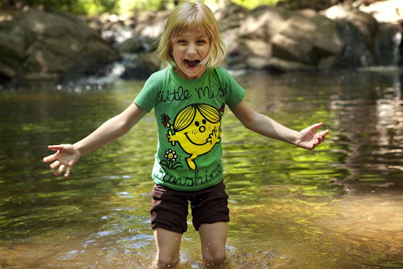 Lori Anne Madison, 6, of Lake Ridge, Va., reacts to the cold water while playing with friends in a park in McLean, Va., on Friday, May 11, 2012. Lori Anne is the youngest contestant in the 2012 National Spelling Bee. (AP Photo/Jacquelyn Martin)