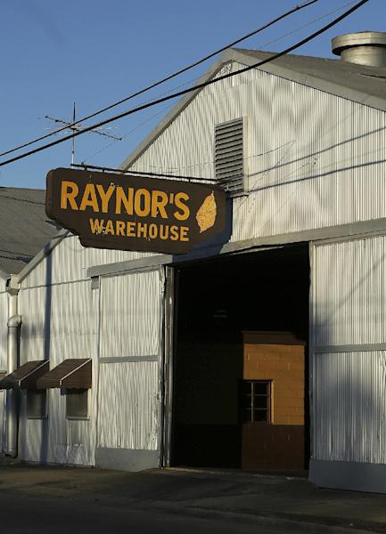 "In this photo taken Friday, March 8, 2013, a tobacco warehouse owned by Roy Johnson Raynor is shown at 1441 S. Church Street in Rocky Mount, N.C. Raynor is one of 41 people who have either pleaded guilty or reached plea agreements after profiting from false insurance claims for losses of tobacco, soybeans, wheat and corn. Prosecutors say bulk tobacco supposedly destroyed by bad weather and pests was secretly sold under false by several brokers in eastern North Carolina, part of a massive crop insurance fraud conspiracy prosecutors say cost the government-backed program $100 million in false claims. Raynor pleaded guilty in 2010 to conspiring to make a false statement, making a material false statement and committing mail and wire fraud. He was sentenced to one year in federal prison for brokering $1.4 million in deals for the ""hidden"" tobacco. (AP Photo/Ted Richardson)"