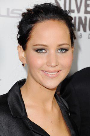 """<p>The oscar winner's role in 'Silver Linings Playbook' required her to dye her hair extremely dark. Here she pulls off the look the Los Angeles premiere of the film.<br/><br><a rel=""""nofollow"""" href=""""http://au.lifestyle.yahoo.com/beauty/tips/article/-/16252253/jennifer-lawrence-goes-gothic-for-hunger-games/"""">Jennifer Lawrence goes gothic for the Hunger Games</a></p>"""