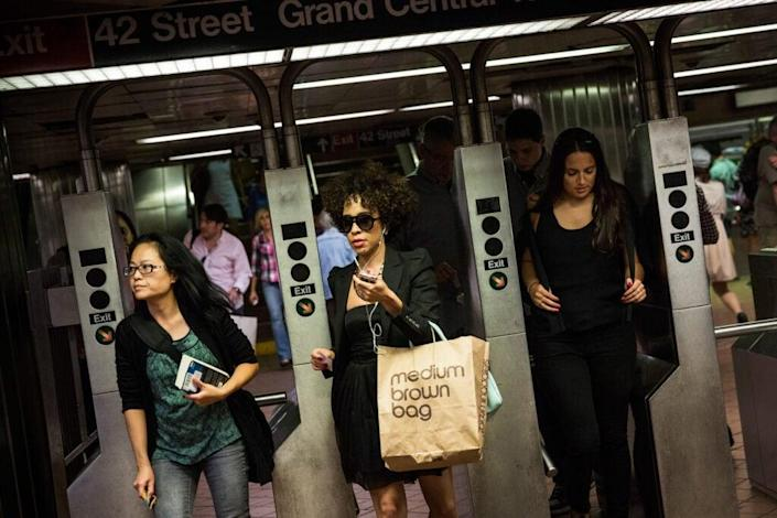 People rush through the New York City subway system at rush hour on August 14, 2013 in New York City. (Photo by Andrew Burton/Getty Images)