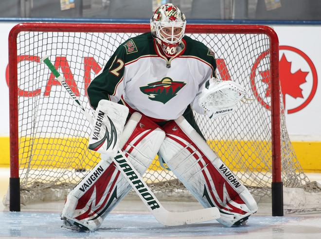 TORONTO, CANADA - JANUARY 19:  Niklas Backstrom #32 of the Minnesota Wild stops shots in the warm-up prior to a game against the Toronto Maple Leafs on January 19, 2012 at the Air Canada Centre in Toronto, Ontario, Canada. (Photo by Claus Andersen/Getty Images)