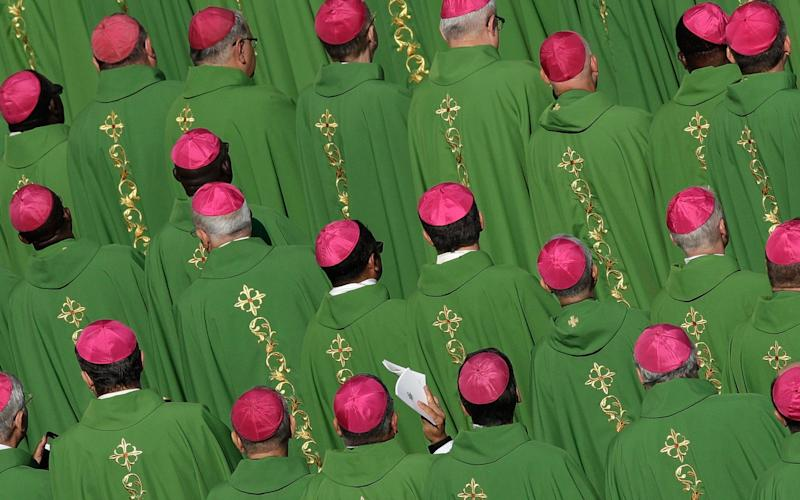 Bishops attend a Mass celebrated by Pope Francis for the opening of a synod, a meeting of bishops, in St. Peter's Square, at the Vatican, Oct. 3, 2018. - AP