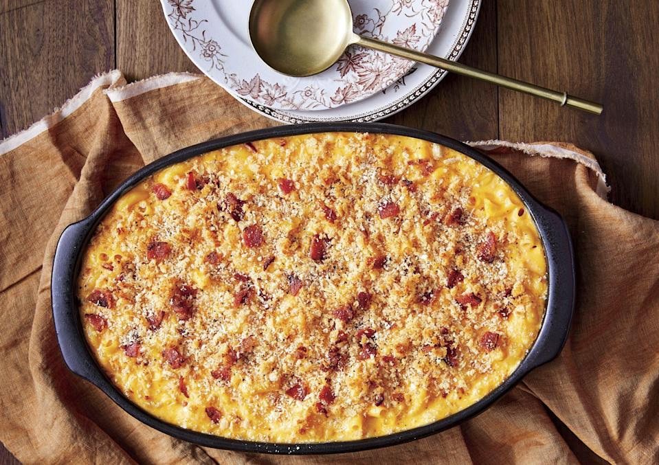 """<p><strong>Recipe: <a href=""""https://www.southernliving.com/recipes/baked-mac-and-cheese-with-bacon"""" rel=""""nofollow noopener"""" target=""""_blank"""" data-ylk=""""slk:Baked Mac and Cheese with Bacon"""" class=""""link rapid-noclick-resp"""">Baked Mac and Cheese with Bacon</a></strong></p> <p>Bacon makes everything better, including macaroni and cheese. This crowd-favorite recipe can be served with virtually any meal. </p>"""