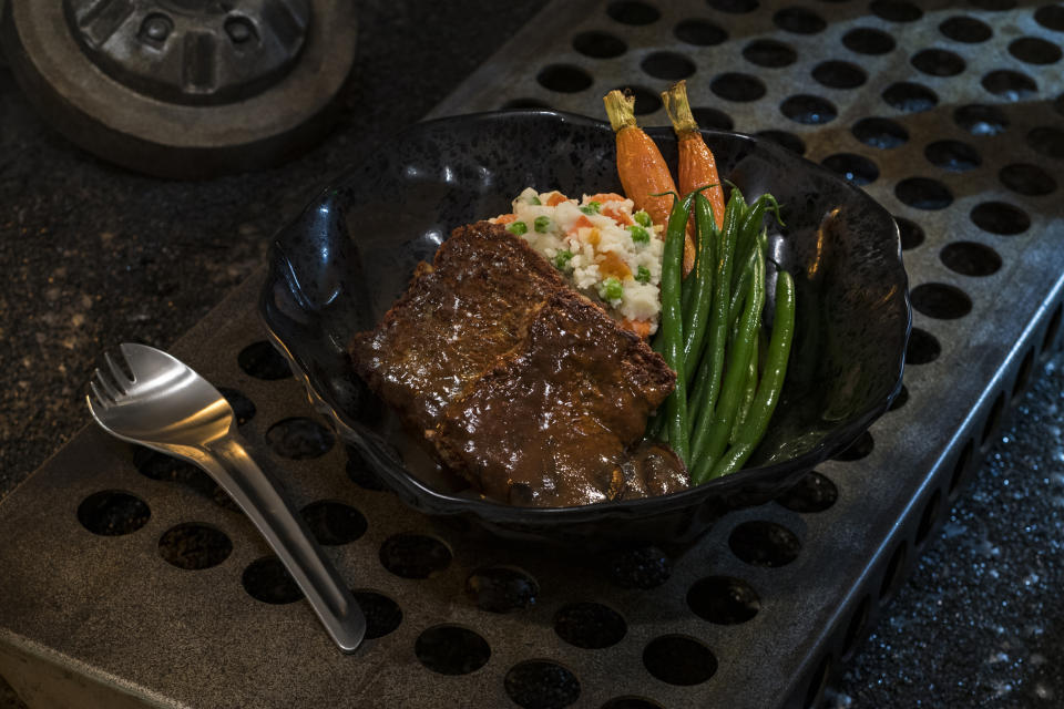"""The Ithorian Garden Loaf, found at Docking Bay 7 Food and Cargo, is a plant-based """"meatloaf"""" dish served with roasted vegetable mash, seasonal vegetables and mushroom sauce. Michele Gendreau, director of food and beverage at Disneyland Resort, told Yahoo Entertainment that the sauce contains four <a href=""""https://www.yahoo.com/entertainment/star-wars-galaxy-edge-food-secrets-inside-disneyland-disney-world-galactic-menu-212455244.html"""" data-ylk=""""slk:&quot;unique mushrooms from around the galaxy.&quot;;outcm:mb_qualified_link;_E:mb_qualified_link;ct:story;"""" class=""""link rapid-noclick-resp yahoo-link"""">""""unique mushrooms from around the galaxy.""""</a> (Photo: David Roark/Disney Parks)"""