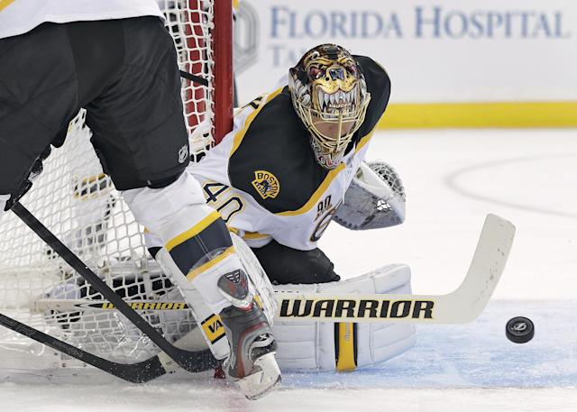 Boston Bruins goalie Tuukka Rask (40), of Finland, makes a stick-save on a shot by the Tampa Bay Lightning during the second period of an NHL hockey game Saturday, Oct. 19, 2013, in Tampa, Fla. (AP Photo/Chris O'Meara)
