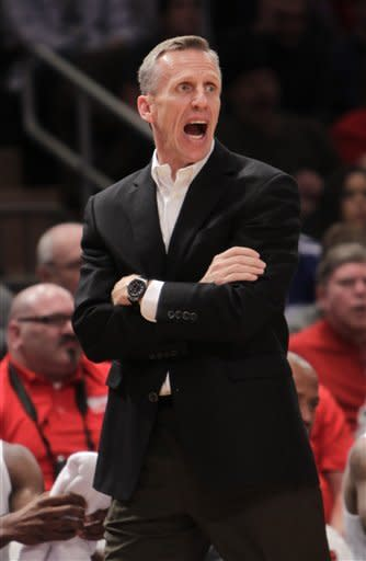 Syracuse assistant coach Mike Dunlap yells during the second half of an NCAA college basketball game against Georgetown in New York, Sunday, Jan. 15, 2012. Georgetown beat St. John's 69-49. (AP Photo/Seth Wenig)