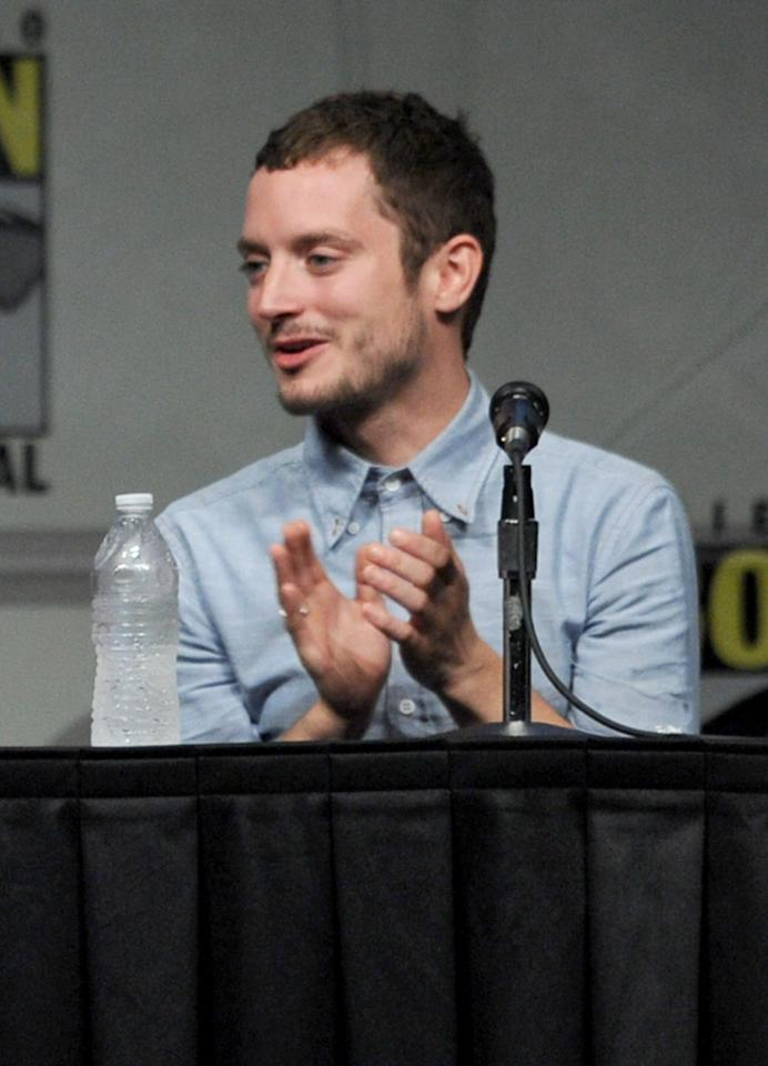 "SAN DIEGO, CA - JULY 14:  Actor Elijah Wood speaks at Warner Bros. Pictures and Legendary Pictures Preview of ""The Hobbit: An Unexpected Journey"" during Comic-Con International 2012 at San Diego Convention Center on July 14, 2012 in San Diego, California.  (Photo by Kevin Winter/Getty Images)"