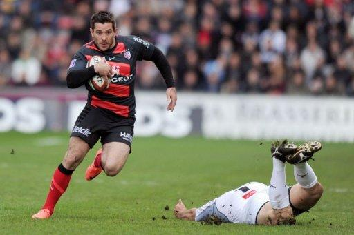 Toulouse's centre Florian Fritz runs with the ball