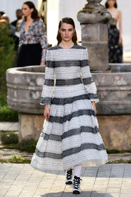 Sober glamour: A crystal-encrusted striped dress at Chanel's haute couture Paris show (AFP Photo/CHRISTOPHE ARCHAMBAULT )