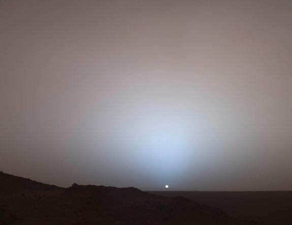 The Mars Rover Spirit took this sublime view of a sunset over the rim of Gusev Crater, about 50 miles (80 kilometers) away. Taken from Husband Hill, it looks much like a sunset on Earth — a reminder that other worlds can seem eerily familiar. S