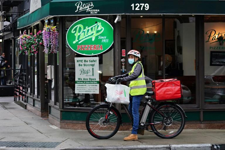 """""""At the end of the day, they take it all,"""" says one restaurant owner about delivery services' commission fees (AFP/Cindy Ord)"""