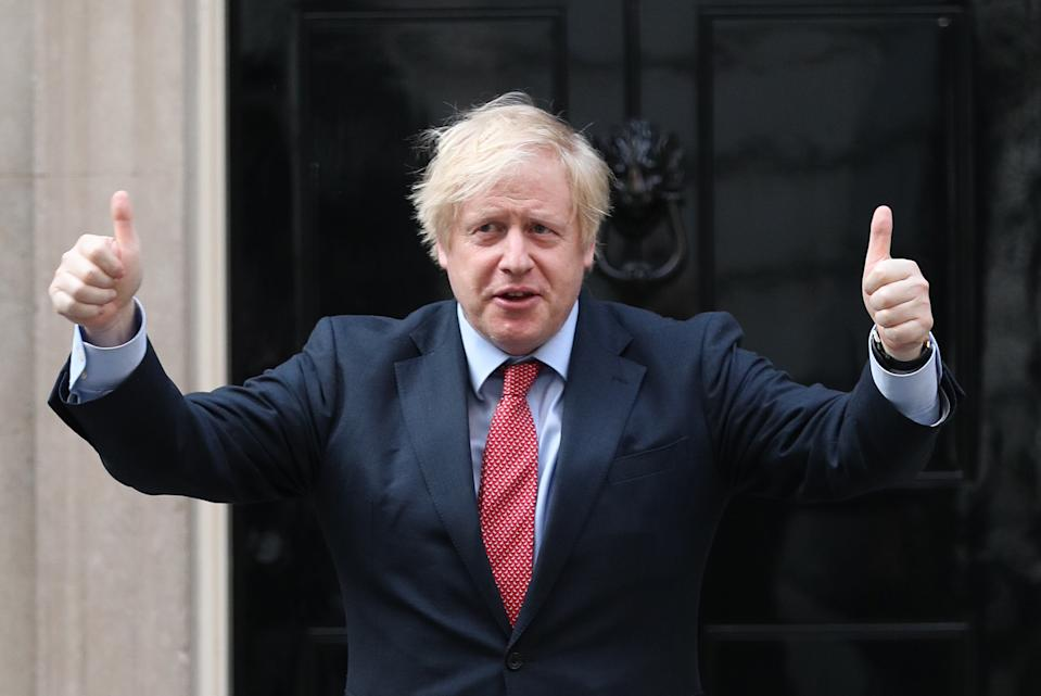 Prime Minister Boris Johnson stands outside 10 Downing Street in London as he joins in the applause to salute local heroes during Thursday's nationwide Clap for Carers to recognise and support NHS workers and carers fighting the coronavirus pandemic. (Photo by Yui Mok/PA Images via Getty Images)