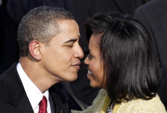 Barack Obama moves to kiss his wife, Michelle, during the inauguration ceremony in Washington, January 20, 2009.