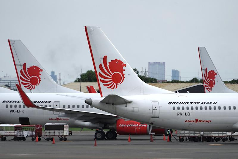 A Lion Air Boeing Co. 737 Max 8 aircraft, right, stands on the tarmac at Soekarno-Hatta International Airport in Cenkareng, Indonesia, on Tuesday, March 12, 2019.
