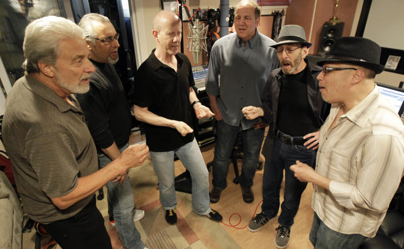 Musicians, from left, Don Ciccone, Lee Shapiro, Jimmy Ryan, Gerry Polci, Larry Gates and Russ Velazquez sing inside a studio, Sunday, May 13, 2012 in Fair Lawn, N.J. Former members of the Four Seasons, minus lead singer Frankie Valli, have teamed up with some A-list studio musicians and have been rehearsing in Gates' basement in preparation for a nationwide tour. (AP Photo/Julio Cortez)
