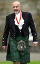 FILE PHOTO: Sir Sean Connery wearing full highland dress walks towards waiting journalists after he was formally knighted by the Britain's Queen Elizabeth at Holyrood Palace in Edinburgh