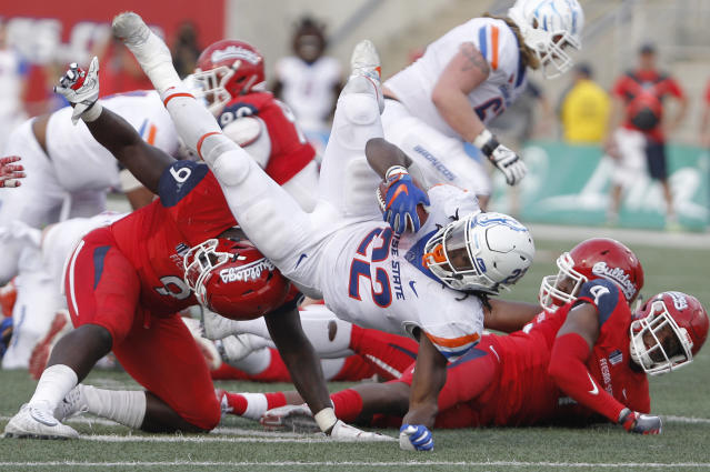 Fresno State's Jeffrey Allison upends Boise State's running back Alexander Mattison in Fresno, Calif., Saturday, Nov. 25, 2017. (AP Photo/Gary Kazanjian)