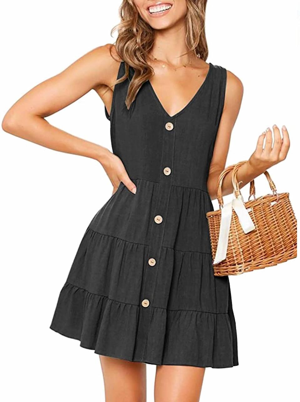 """A playful pick for anyone who sticks to all black everything year-round. $22, Amazon. <a href=""""https://www.amazon.com/MITILLY-Womens-Summer-Sleeveless-Button/dp/B07PQW4X25"""" rel=""""nofollow noopener"""" target=""""_blank"""" data-ylk=""""slk:Get it now!"""" class=""""link rapid-noclick-resp"""">Get it now!</a>"""