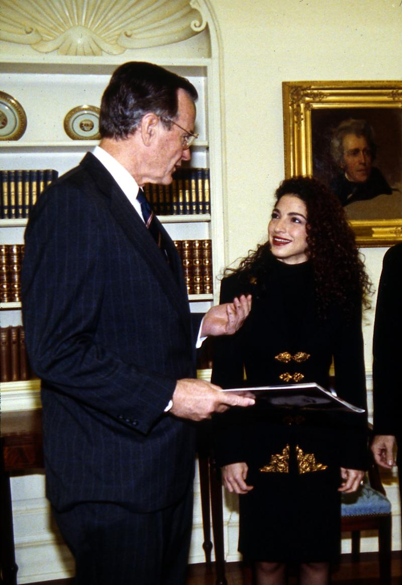 President George H.W. Bush with singer Gloria Estefan at the White House in 1990. (Photo: AP)