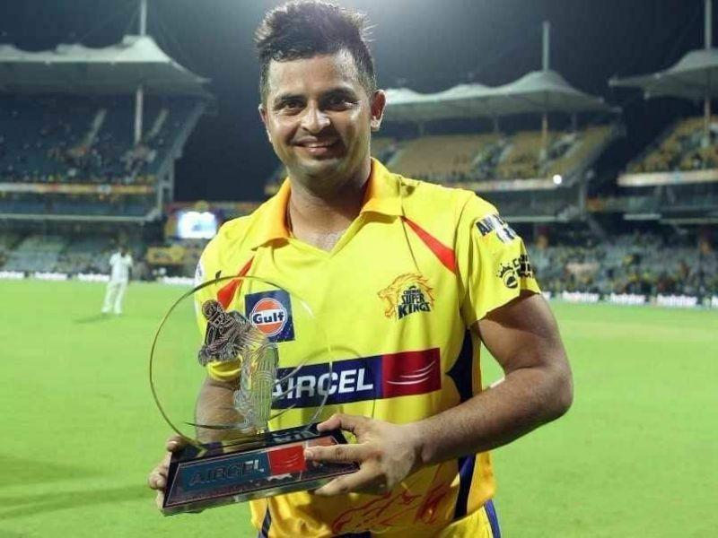 Suresh Raina poses with a trophy