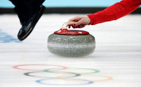FILE PHOTO: Britain's skip Eve Muirhead delivers a stone during their women's curling bronze medal game at the 2014 Sochi Winter Olympics in the Ice Cube Curling Centre in Sochi February 20, 2014. REUTERS/Phil Noble/File photo