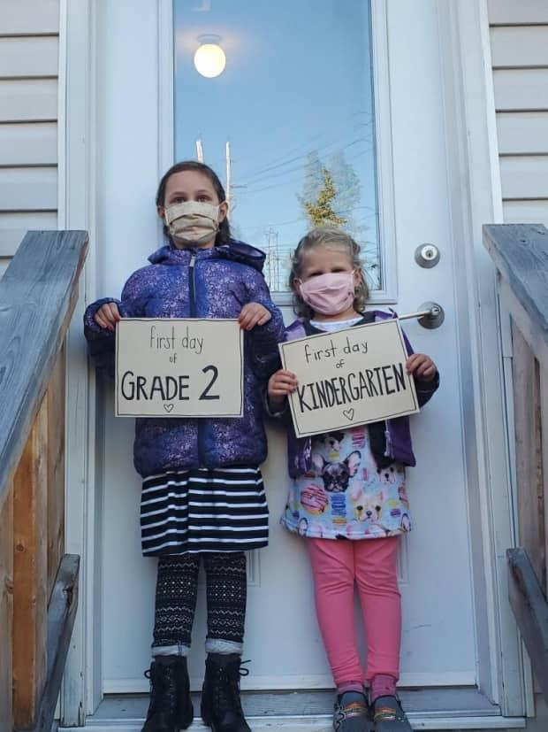Myriad, left, and Iggy Fitzky pictured last year as they prepared for the first day of school amid a global pandemic. (Submitted by Susan Fitzky - image credit)